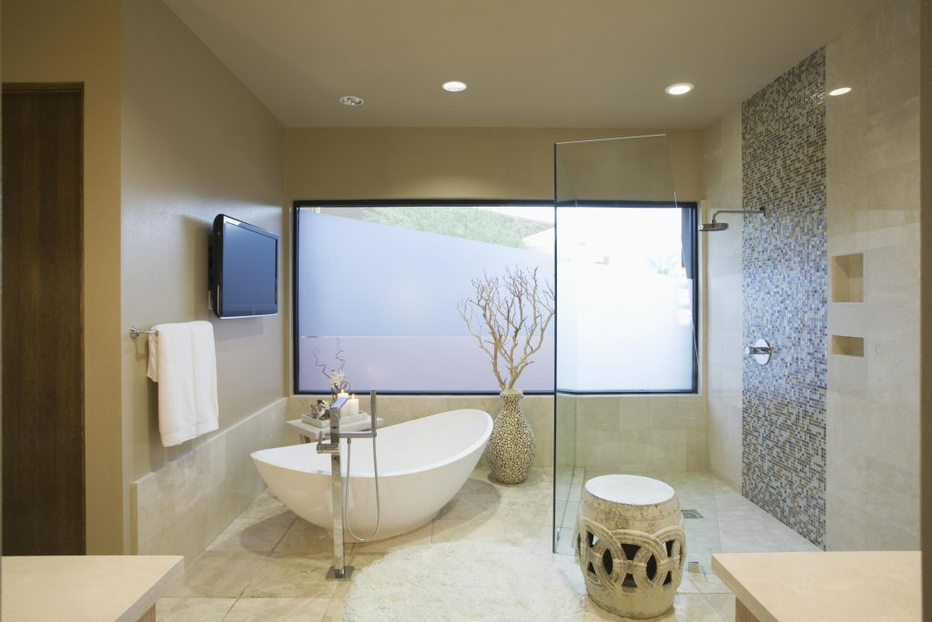 minimalist clean bathroom with marble tiles and wall